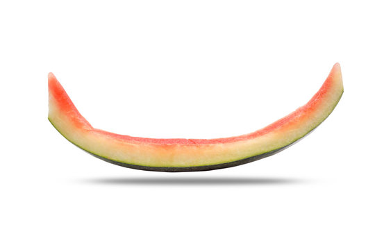 Slice of watermelon rind after eaten up on the white background and the shadow below.