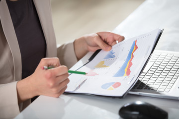 Businesswoman Holding Graph And Pencil