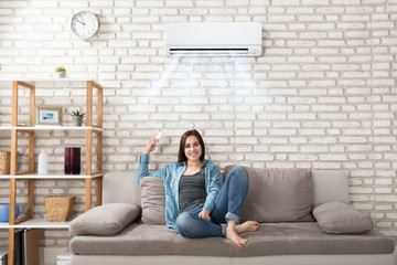 Woman Relaxing Under The Air Conditioner Wall mural
