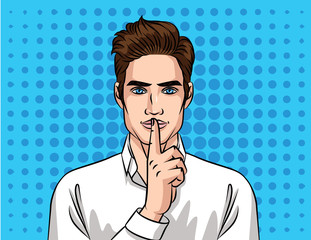 Young handsome guy European type  holding a finger to his mouth. Face of man  over halftone background effect