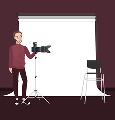 photographer man standing holding camera with tripod on studio equipment