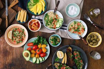 Vegetarian salad, vegetables, stuffed eggplant, fruit and snacks. Vegetarian food