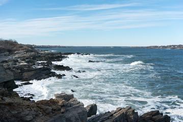 Waves crashing on rocky shoreline