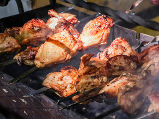 Skewers of chicken. Poultry meat cooked on the coals.