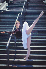 Young beautiful ballerina in city at sunny day, dancing and give a positive and inspiration for other people