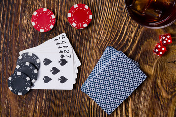 Big game of poker and dice on a wooden background