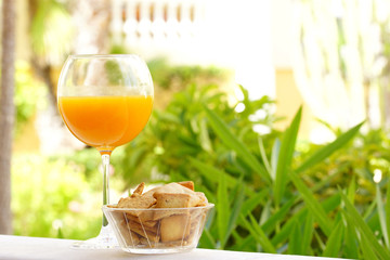 Glass of natural orange juice for the healthy breakfast in vacation