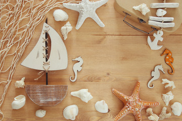 Top view of Nautical concept with sea life style objects on wooden table
