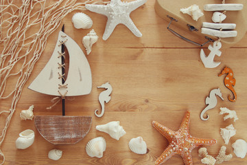 Nautical concept with sea life style objects on wooden table. Top view