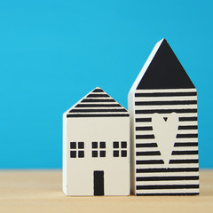 small house model over wooden floor. selective focus