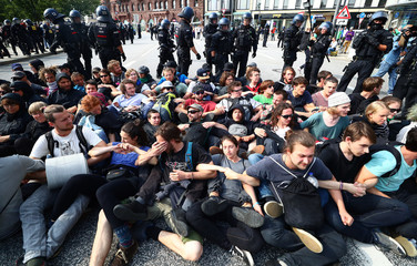 Protestors who are blocking a street are surrounded by German police at a demonstration during the G20 summit in Hamburg