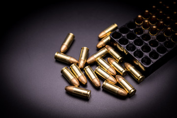 9 mm full metal jacket bullet on black background
