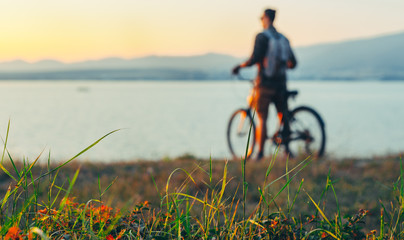 Unrecognizable Man Cyclist Standing With Bike On Coast And Enjoying View of Nature Sunset Vacation Traveling Destination Resting Concept, Selective Focus