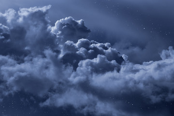 Cloudy night sky with stars