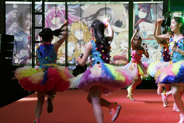 Girls perform at the China International Comics Games Expo in Shanghai