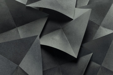 Geometric shapes of paper, grey background