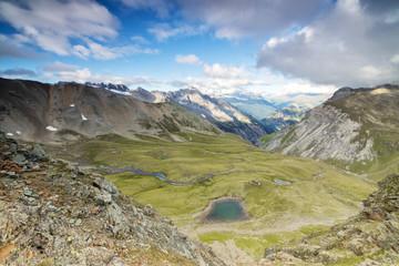 High peaks frame the alpine lakes and meadows, Filon Del Mott, Bormio, Braulio Valley, Stelvio Pass, Valtellina, Lombardy, Italy, Europe