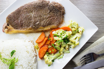 pork or beef steak with Mixed vegetables and rice
