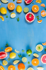 citrus food flat lay borders pattern on blue background - assorted citrus fruits with mint leaves