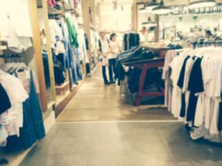 Blurred interior fashion clothes store.