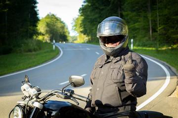 Biker shows the middle finger
