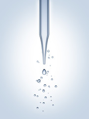 Close up pipette with drop on white