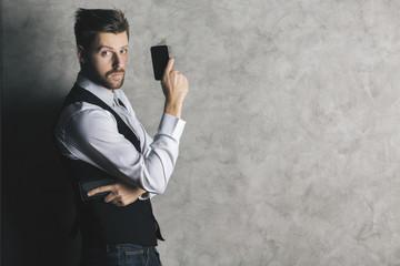 Businessman with cellphone gun