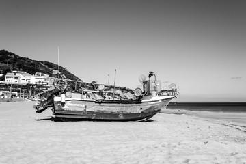Stranded boat in the beach of Salema (Algarve, Portugal)