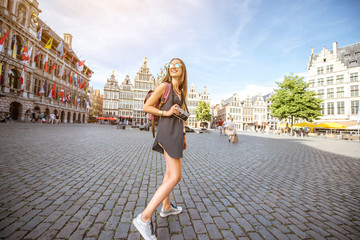 Poster de jardin Antwerp Young woman tourist with photo camera walking on the Great Market square in Antwerpen city in Belgium