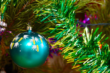 Beautiful decorative glass toys and decorations on Christmas tree branches