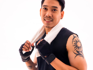 Handsome fit man holding a towel with happy fitness.