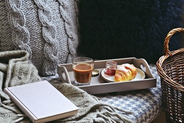 Cozy home with cup of coffee and a book. Hygge style