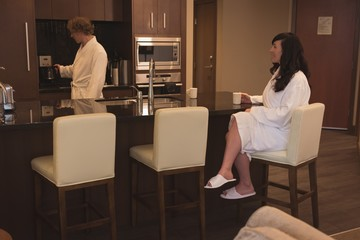 Couple having coffee in the kitchen