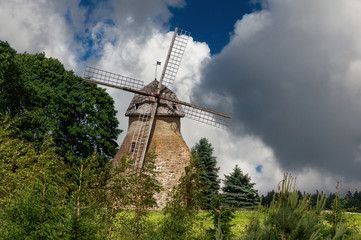 medieval windmill in village Aaspere. Old rural attraction in Estonia. The historic architecture. The summer season.