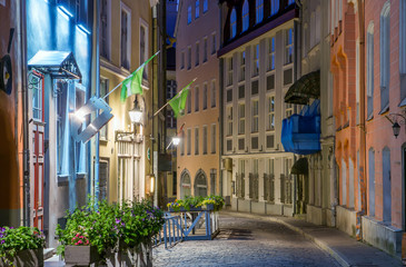 colorful medieval street in Tallinn's old town. Beautiful narrow alley in the summer white night. Attraction In Estonia.