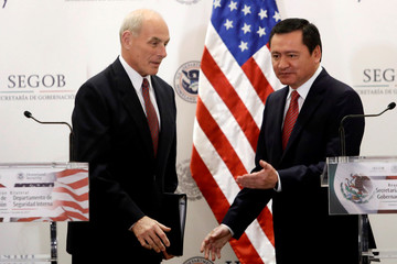 U.S. Secretary of Homeland Security John Kelly and Mexico's Interior Minister Miguel Angel Osorio Chong are pictured after delivering a joint message at the Secretary of Interior Building in Mexico City