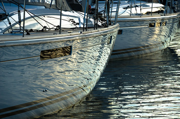 water reflections on sailboat