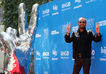 """Musician Starr poses during a """"Peace & Love"""" event to celebrate Starr's 77th birthday in Los Angeles"""
