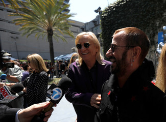 """Musicians Starr and Walsh are interviewed during a """"Peace & Love"""" event to celebrate Starr's 77th birthday in Los Angeles"""
