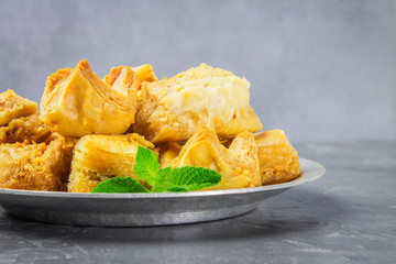 Jewish, turkish, arabic traditional national dessert. Macro. Selective focus. Baklava with honey and nuts