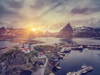 The Typical Norwegian fishing village on the Lofoten in northern Norway Under midnight sun, with the typical rorbu houses.