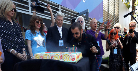 """Musician Starr blows candles at a """"Peace & Love"""" event to celebrate Starr's 77th birthday in Los Angeles"""