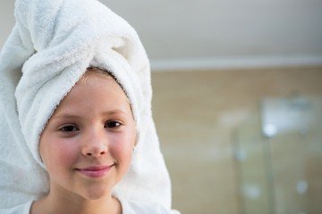 Portrait of girl with hair wrapped in towel