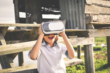 Asian girl playing VR virtual reality glass box ,color of vintage style and soft focus