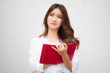Portrait of thai adult working women white shirt Write book
