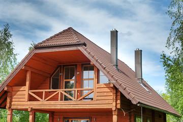 Upper part of wooden cottage.