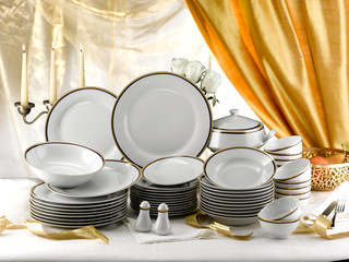 elegant set of  porcelain plates  ready for a buffet dinner