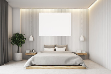 Beige bedroom with a poster