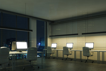 Blank computer screens in a night office, corner