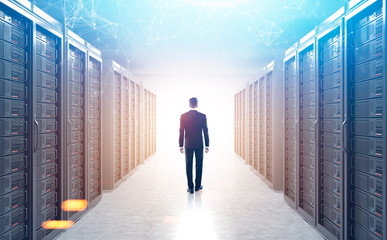 Rear view of man in a server room, sunlight